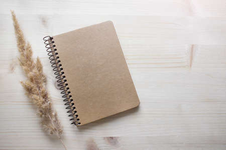 Mockup template with black blank empty notebook cover on wooden background. Photo with copy blank space.