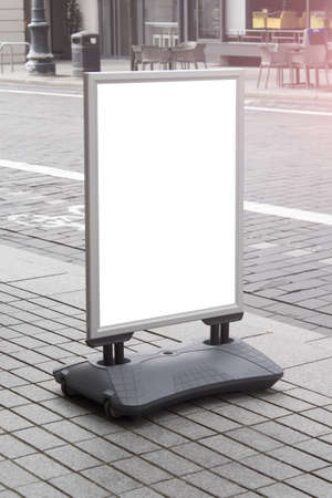 Mockup template of street cafe shop stand signboard in the european city center.