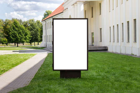 Mockup template of street lightbox stand signboard in the european city center in summertime.