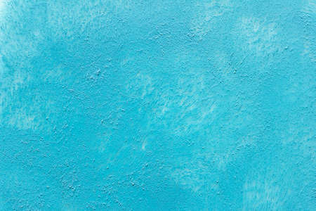 Textured blue acrylic paint background with marks left by sponge. 免版税图像