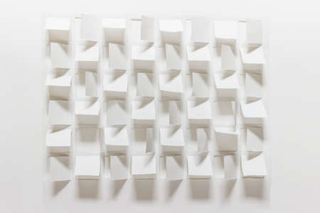 Abstract paper background with pattern of many squares on white paper.