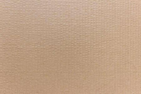 Plain blank brown paper cardboard background with vertical lines.