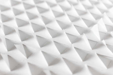 White paper 3d pattern with repeating triangle shapes made of white paper.