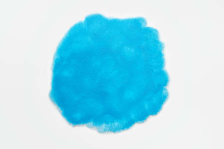 Abstract blue acrylic paint circle on white background.