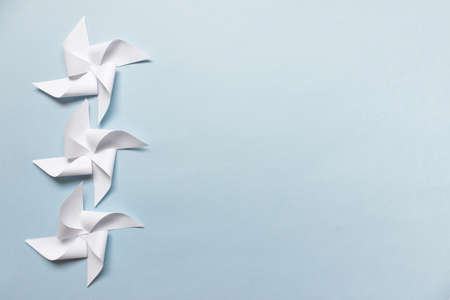 Simple mockup with three paper origami figures on blue background. Photo with copy blank space.