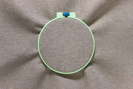 Mockup template sewing ring with textured fabric. Photo with copy blank space. 免版税图像