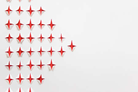 Paper background with hand cut geometric shapes red stars. Photo with copy blank space.