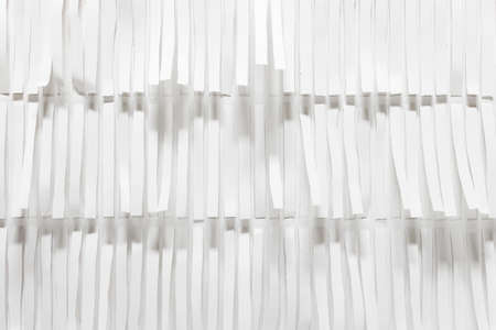 Abstract white hand made 3d pattern with long white paper strips.