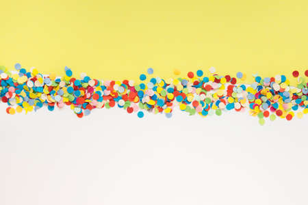 Colorful background with two layers of paper and colorful confetti. 免版税图像