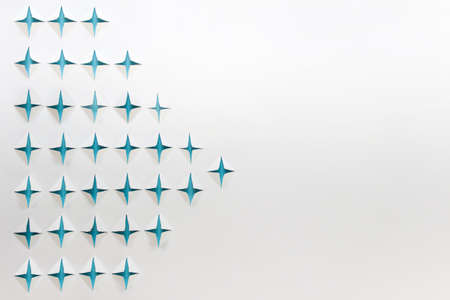 Abstract background with paper cut blue stars on white background. Photo with copy blank space.