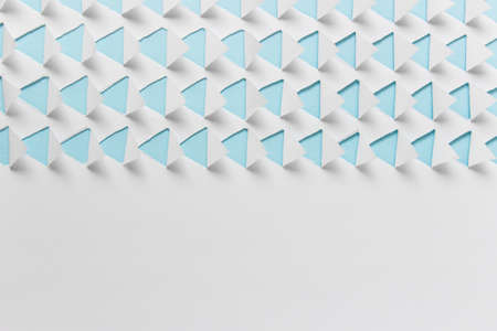 Abstract handmade pattern with triangles on blue paper. Photo with copy blank space. 免版税图像