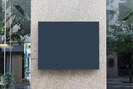 Shop exterior mockup template with blank large black gray board.