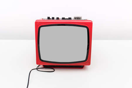 Old fashioned retro TV with plastic box on white background.