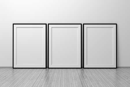 Mockup template of three A4 frames with thin black frame border standing next to wall on wooden floor. 3d illustration.