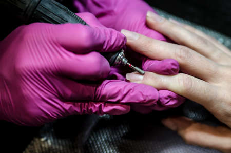 Hardware manicure. The process of removing the remnants of the cuticle and polishing with a router.