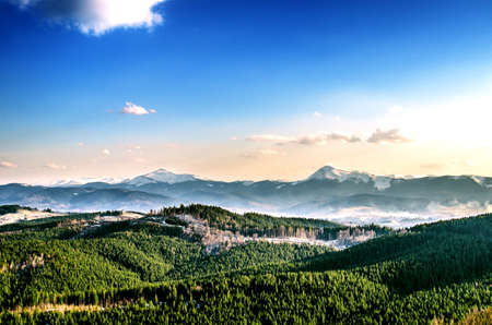 Ukrainian carpathians in the light of the passing sun are shrouded in haze.