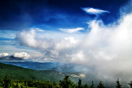 A cloud slowly covering the mountains. Carpathians. Ukraine. Banco de Imagens