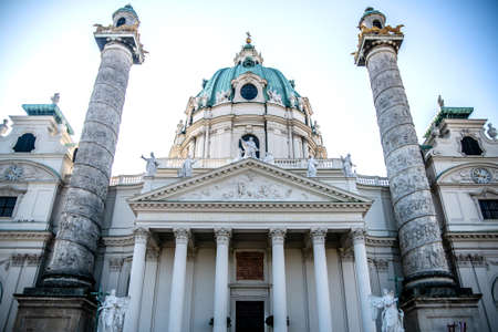 Horizontal photo of the Karlskirche church and beautiful tall columns on either side of the entrance. Vienna Austria 写真素材