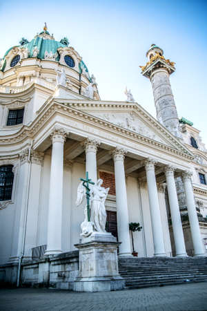 View of Karlskirche and sculptures in front of the entrance to the cathedral. Vienna Austria 写真素材