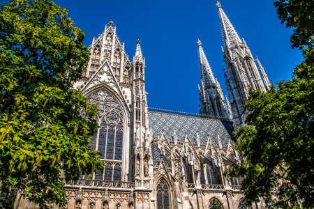 The majestic beautiful church of Votivkirche against the blue sky. Vein. Austria