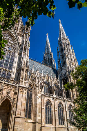 Towers of Votivkirche Church against the blue sky. Vienna Austria