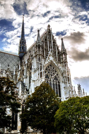 Incredibly beautiful cathedral of Votivkirche against a cloudy sky. Vienna Austria