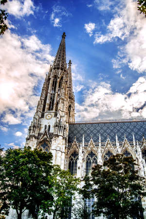 Towers of the Cathedral of Votivkirche against a cloudy sky. Vienna Austria
