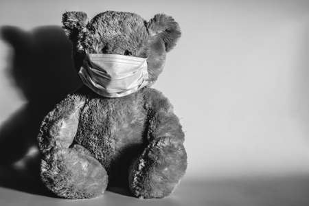 Teddy bear in a protective medical mask.