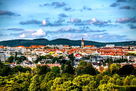View of Vienna and its colorful houses with orange roofs. Austria.