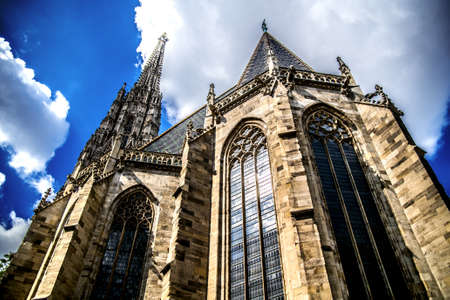 St. Stephen's Cathedral towers up to a slightly cloudy blue sky. Vienna Austria 写真素材