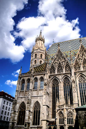 St. Stephen's Cathedral against the blue sky, decorated with fluffy clouds. Vienna Austria