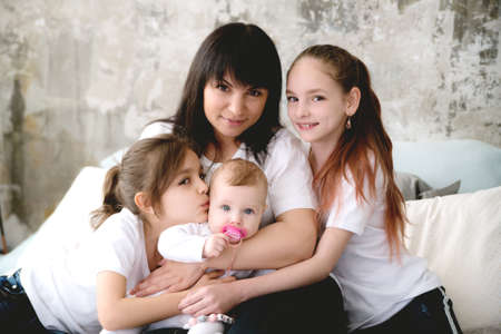 Mom surrounded by her beloved three daughters. 写真素材