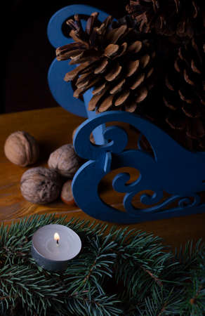 Christmas decoration with fir tree, candles and bumps. Traditional decor for winter time