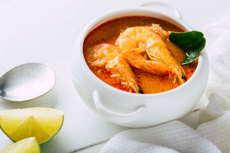 Tom yum with shrimp on a white plate, Traditional Thai food Stock Photo