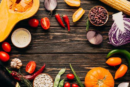 Food frame. Fresh Vegetables on a Wooden Background. Copy Place Stock fotó