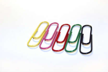 Colored paper clips isolated on white