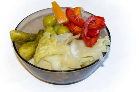 Marinated salted vegetables: cucumbers, carrots, peppers, tomatoes, cabbage isolated on white background