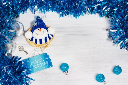 Christmas decoration with different decorative elements in blue colors on rusty white background photo