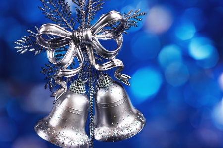 Christmas decoration with silver bells with blue blurred background photo