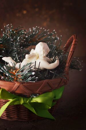 Christmas decoration with little cute angel in a wicker basket photo