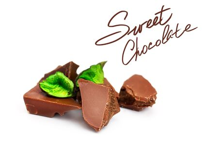 Chocolate pieces on a white background, with green decor