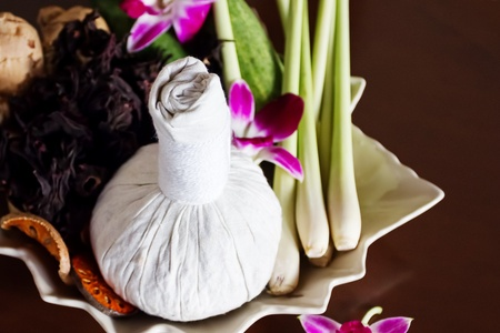 Thai spa massage. Herbal bag, orchids, decor. photo