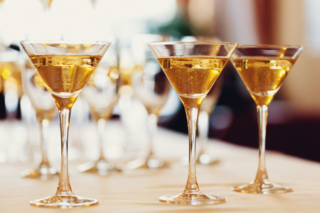 christmas champagne: Celebration. Champagne glasses. Gently toned, selective focus. Stock Photo