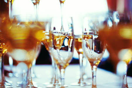 holiday catering: Celebration. Abstract picture of champagne glasses. Gently toned, vintage colors, selective focus.