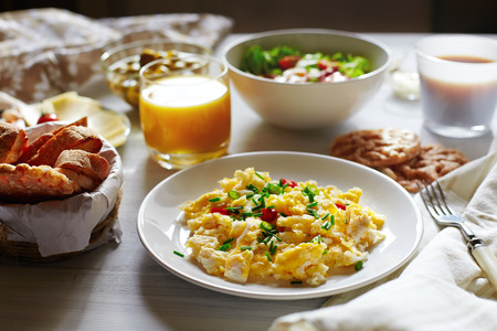 Fresh breakfast food  Scrambled eggs, bread, coffee and orange juice  Cocept of nutritious healthy food or continental breakfast