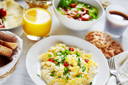 egg cup: Fresh breakfast food  Scrambled eggs, salad, coffee and orange juice  Concept of  healthy food or continental breakfast  Stock Photo