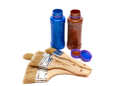 Renovation tools: five new different brushes with paint on white background. Selective focus. photo