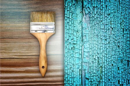 repaint: Renovation brush on wooden and old blue cracked texture. Space for your text. Stock Photo