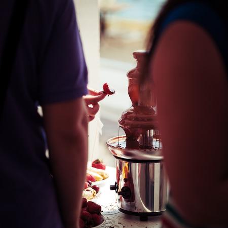 Chocolate fondue fountain.  photo