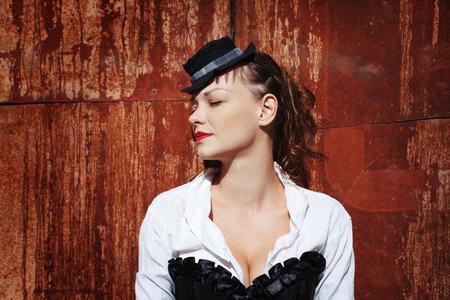 Grunge portrait of beautiful woman. Steampunk style. photo